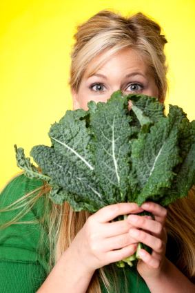 kale woman leafy greens vegetables