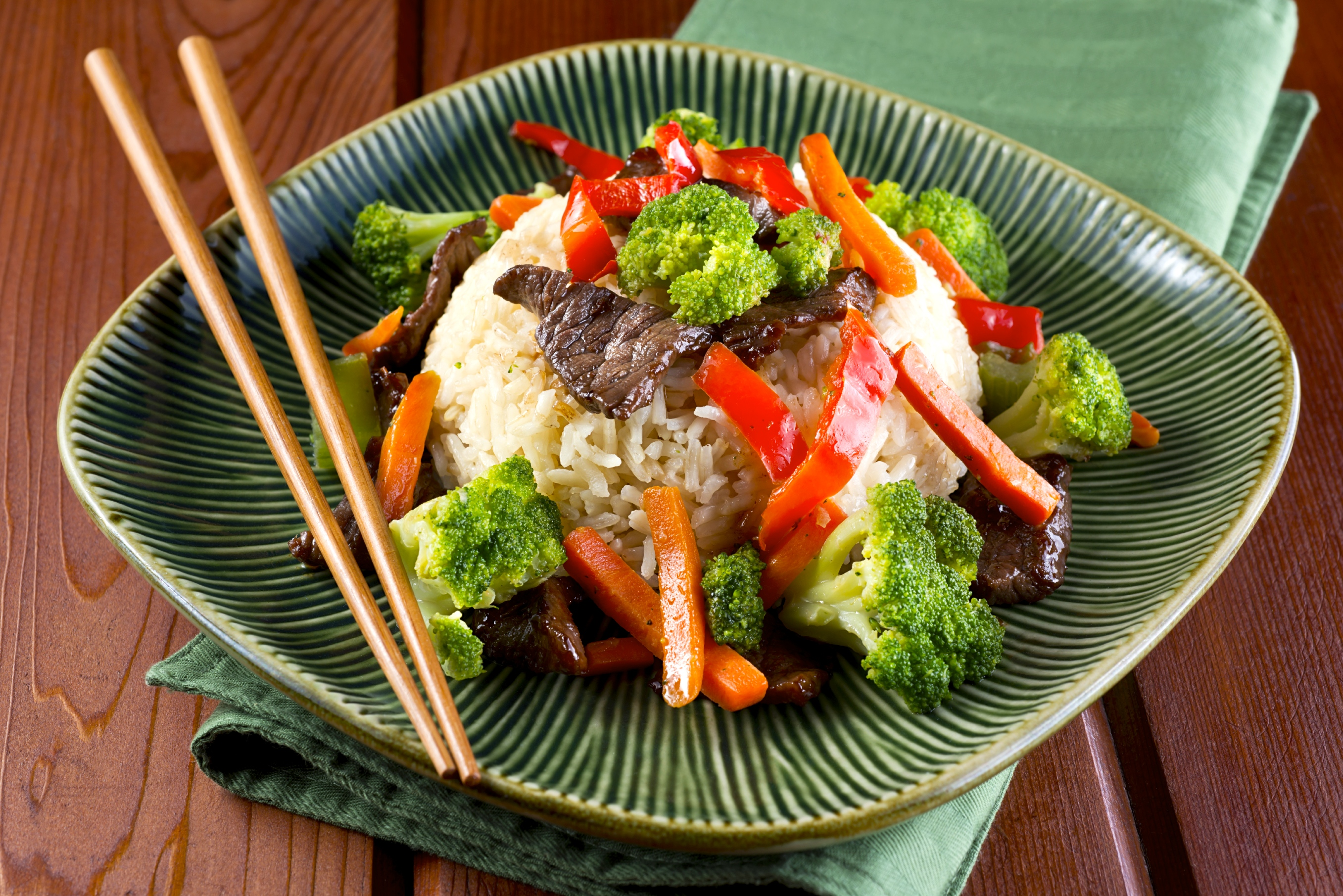 Plate of Beef and Broccoli Stir Fry with Carrots and Bell Pepper