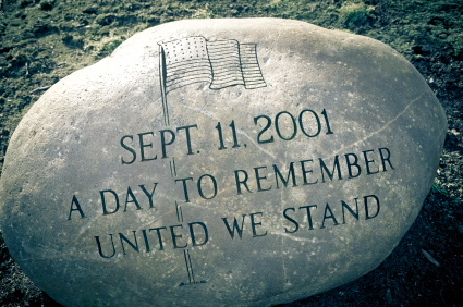 A 911 memorial carved into a granite rock
